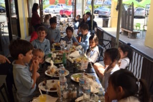 First Grade Experiences Brazilian Culture on Field Trip