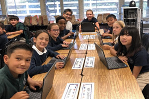 Grade 5 students learning how to use their Chromebooks with help from Mr. Sato!